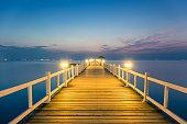 Wood bridge with seascape at twilight time.