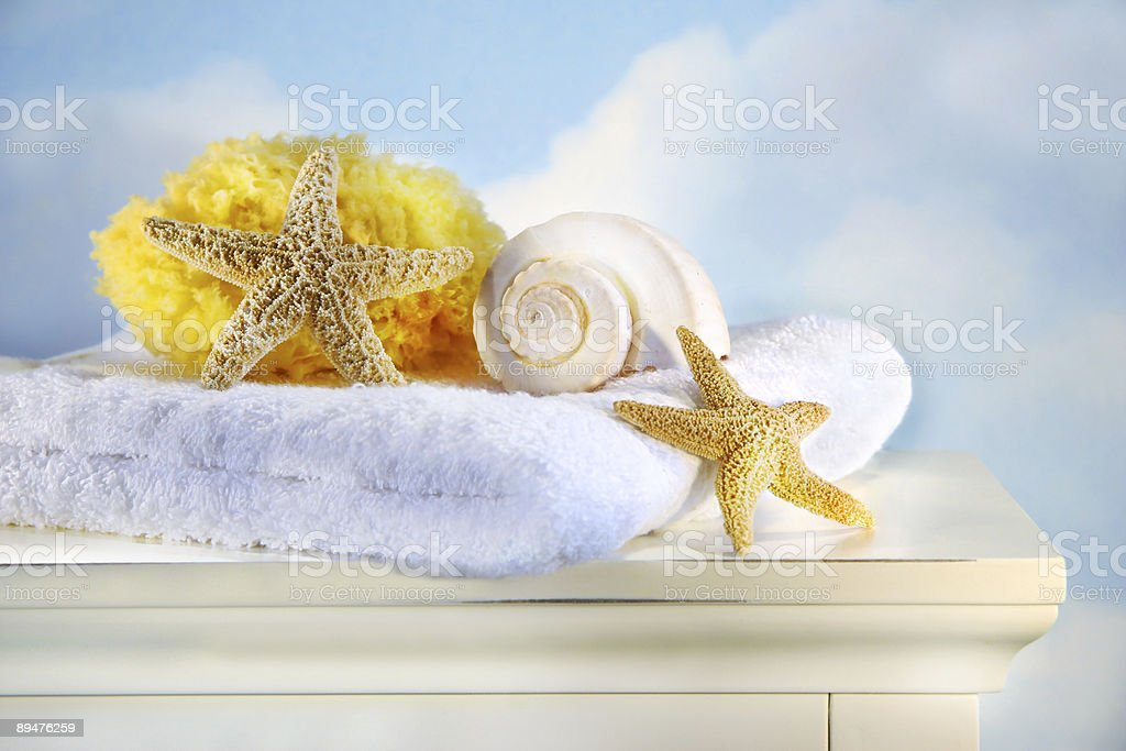 Sea shells and towel on cabinet royalty-free stock photo