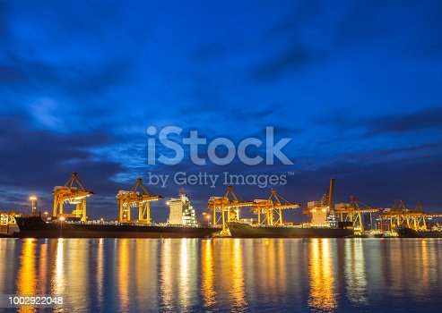 Sea ship at dock with working crane lift container for shipping or delivery background.