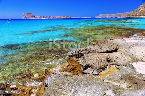 istock Sea shore with clear sea water and stone. 973009030
