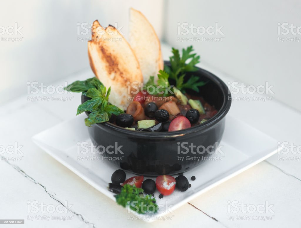Sea soup in the black bowl stock photo