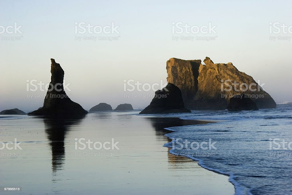 Sea Stacks and Rising Sun royalty-free stock photo