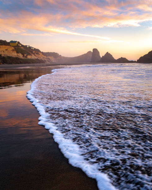 Sea stacks in the Pacific ocean during sunset stock photo