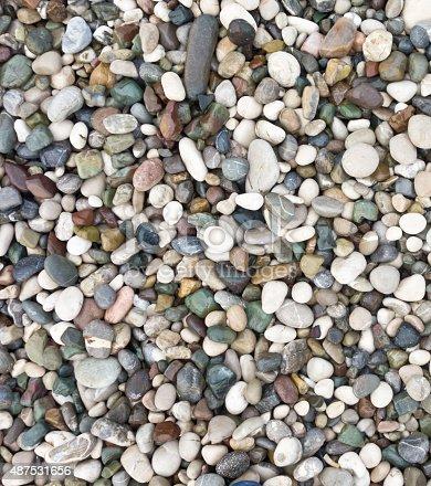 istock sea stone background 487531656
