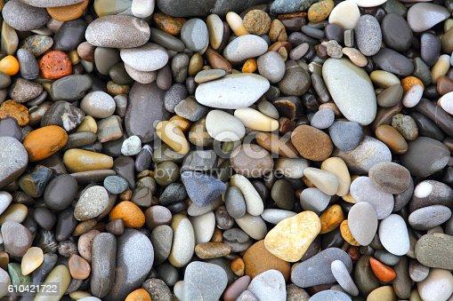 istock Sea stones background 610421722