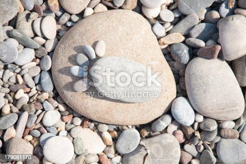 istock sea stones laid out in the form of foot prints 179061170