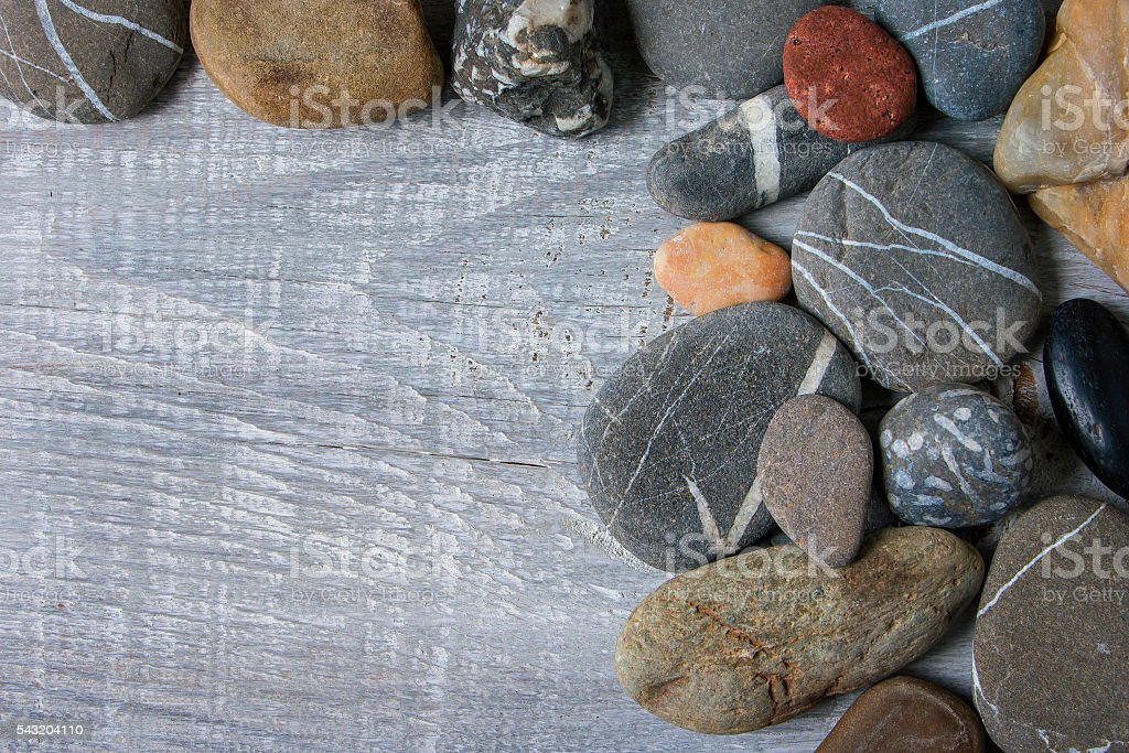 Sea stones lie on the board stock photo