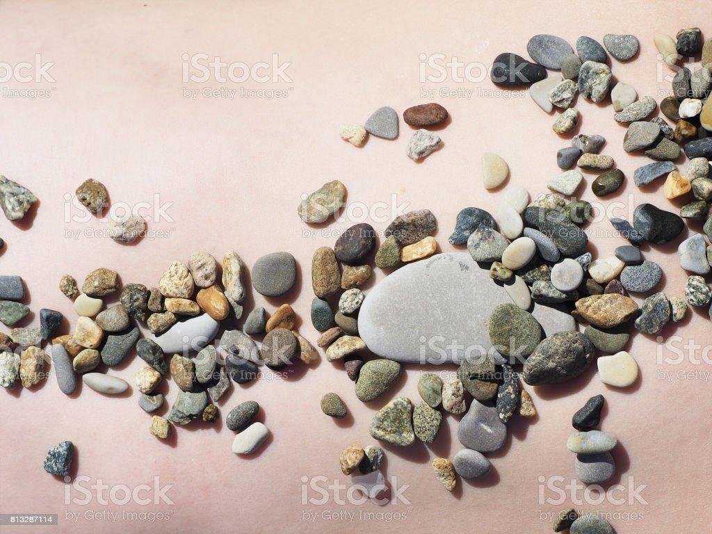 Sea stones on the human body stock photo