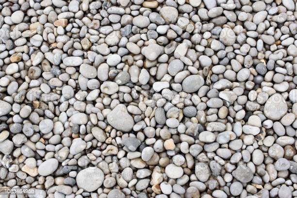 Photo of Sea stones. Pebbles. Nautical background. Texture nature background from sea pebbles.