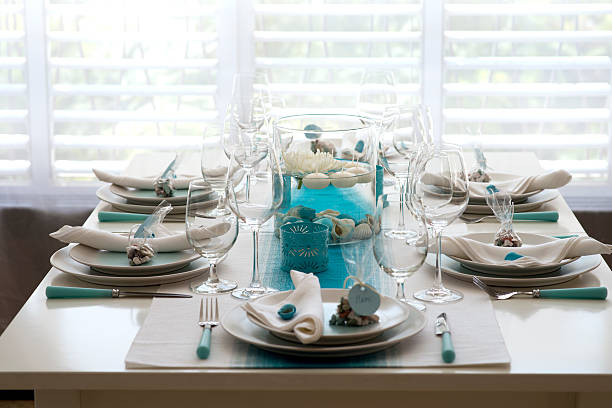 sea style table setting for dinner - blue table setting stock photos and pictures