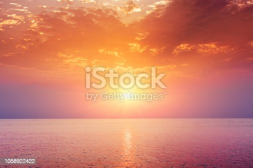 Sunset sky above sea, sunrise landscape