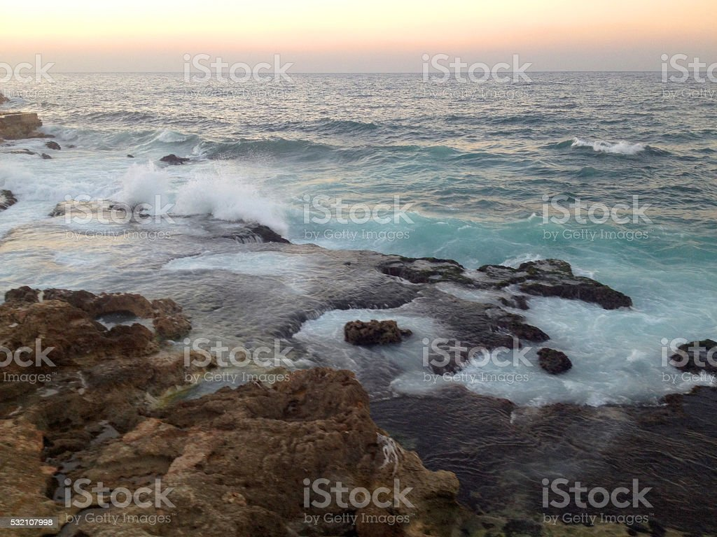 Sea surf and Rock stock photo