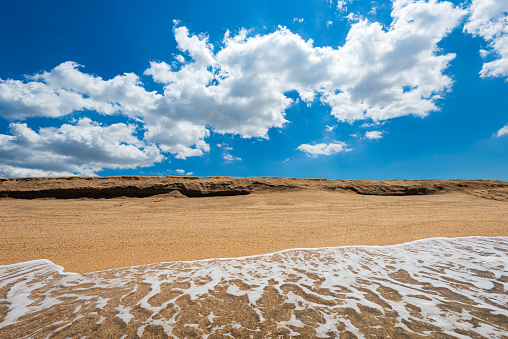 483422527 istock photo Sea surf with clear water and yellow hot sand, summer beach with clouds 1263275775