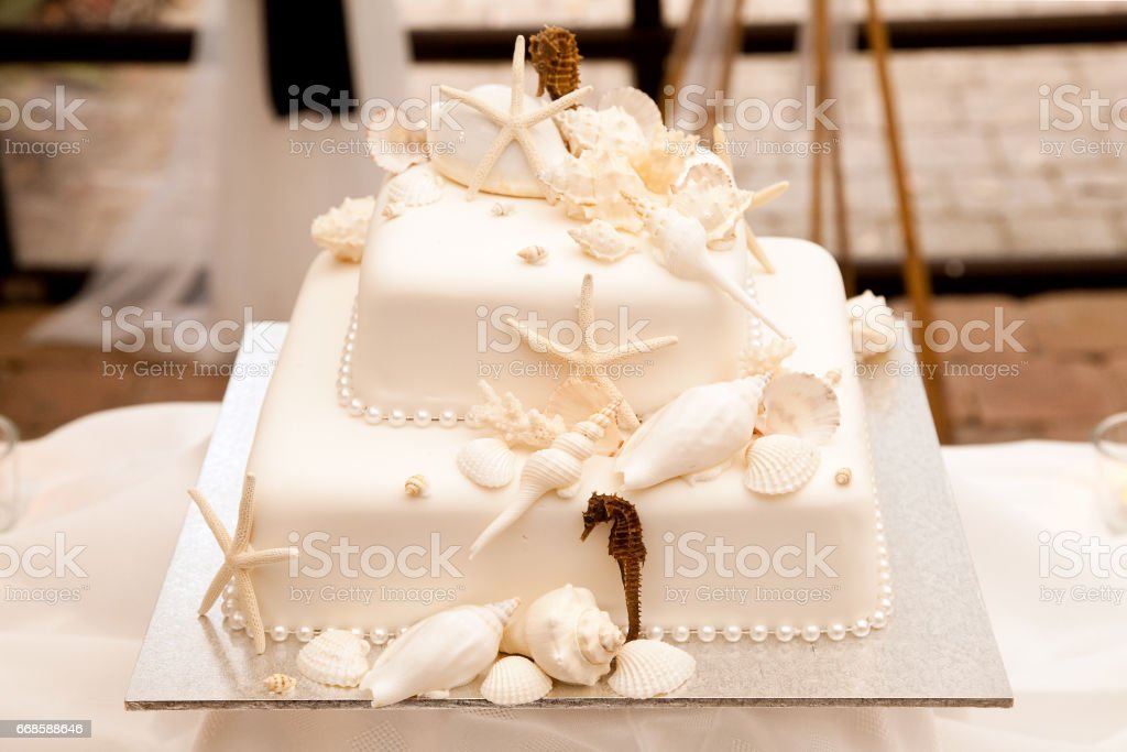 Sea Theme Wedding Cake With Shells Starfish And Seahorse Stock Photo