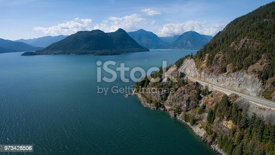 Aerial view of the Sea to Sky Highway in Howe Sound, North of Vancouver, British Columbia, Canada.
