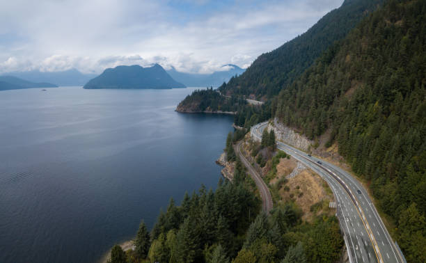 Sea to Sky Highway Aerial drone panoramic view of Sea to Sky Highway during a bright summer day. Taken North of Vancouver, British Columbia, Canada. british columbia stock pictures, royalty-free photos & images