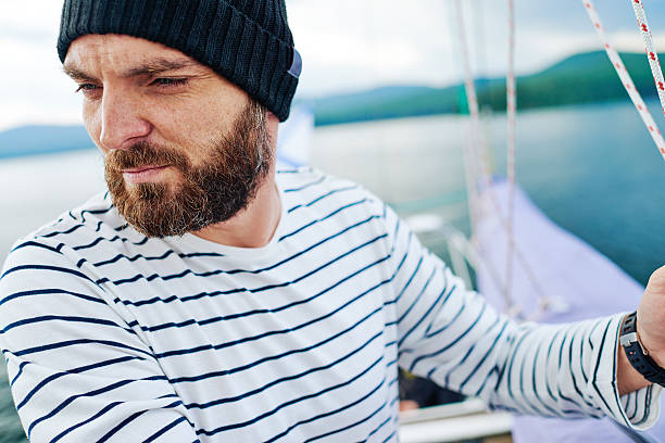 Sea travel Seaman standing on ship sailor suit stock pictures, royalty-free photos & images