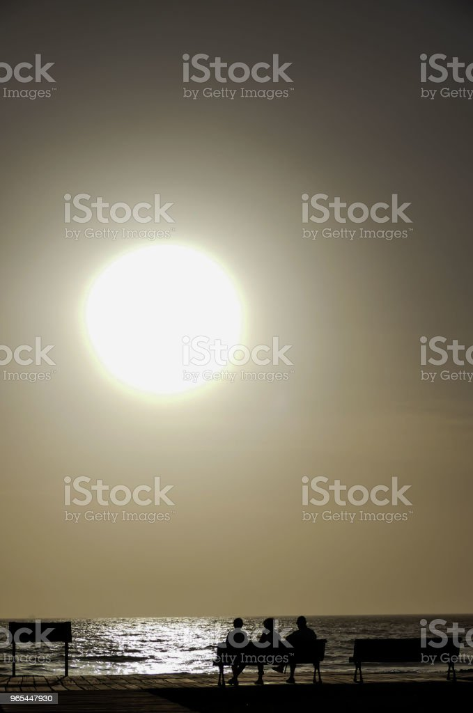 Sea Tropical Sunset with people silhouette royalty-free stock photo