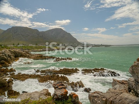 Sea shore, mountains in the background