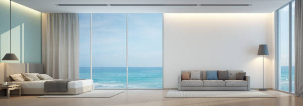 Sea view bedroom and living room in luxury beach house stock photo