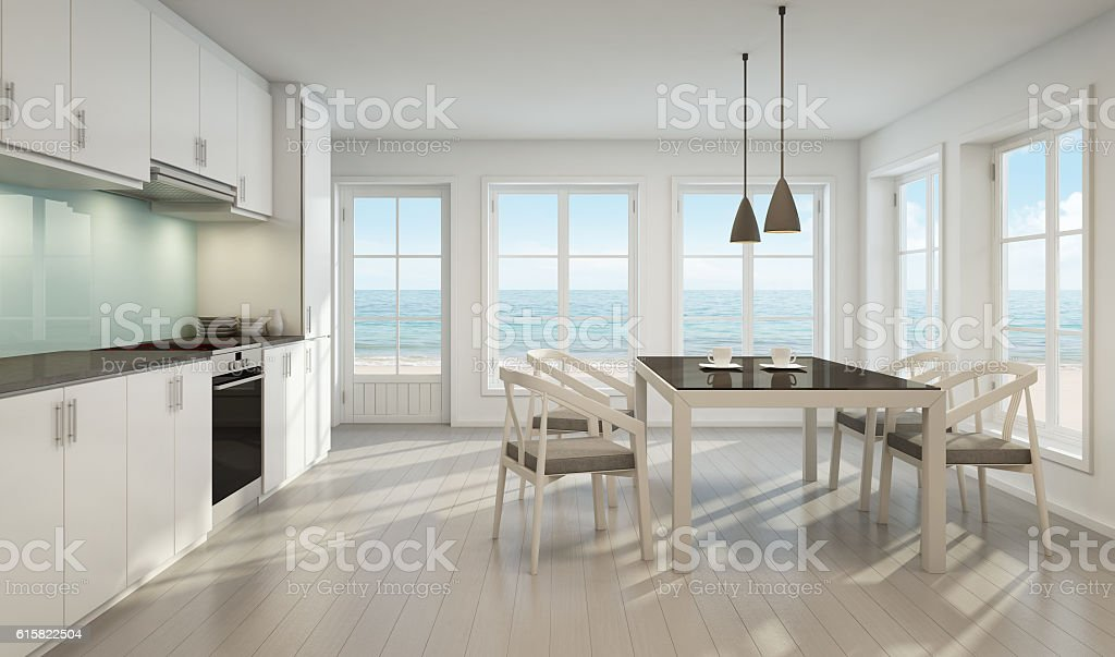 Sea view dining room and kitchen in beach house stock photo
