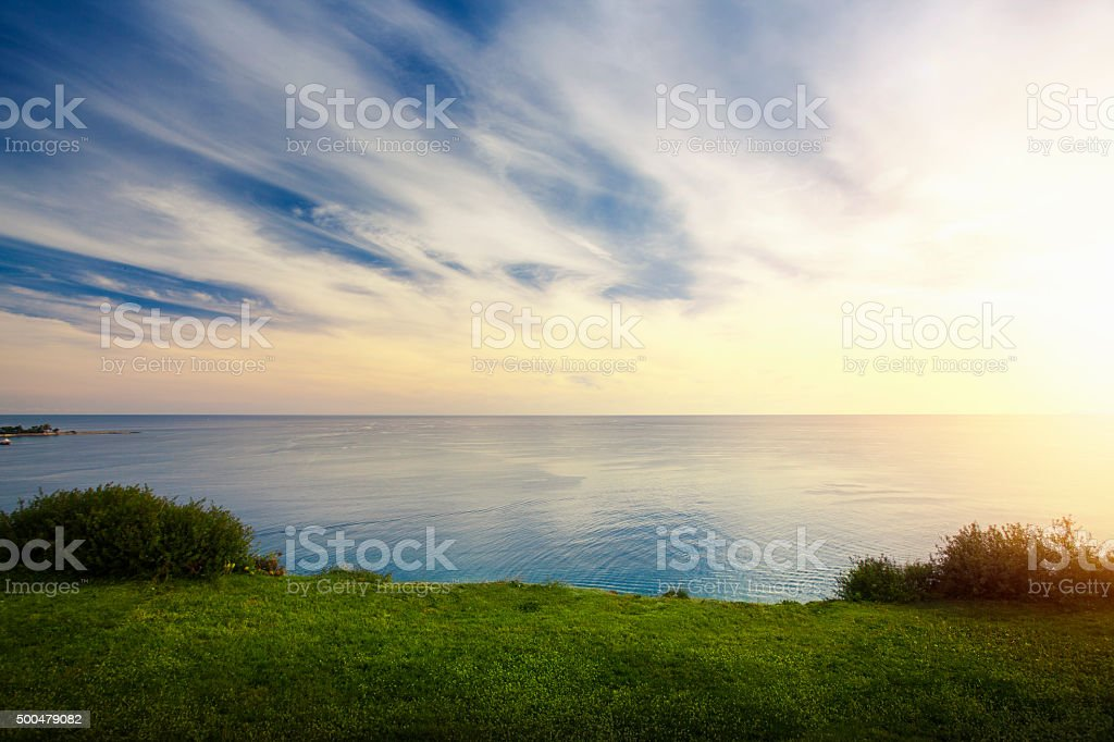 Sea view from green grassy hill stock photo