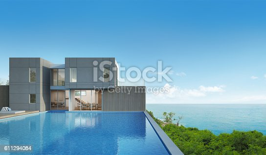 istock sea view house with pool in modern design 611294084