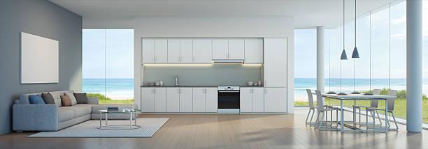 sea view kitchen, dining and living room in beach house - wohnschrank stock-fotos und bilder