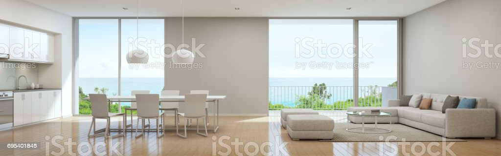 Sea view kitchen, dining and living room of luxury beach house in modern design, Vacation home for big family stock photo