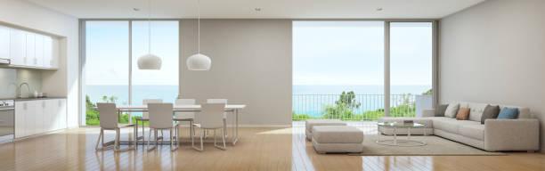 meer blick küche, ess- und wohnzimmer luxus strandvilla in modernem design, ferienhaus für große familie - große wohnzimmer stock-fotos und bilder