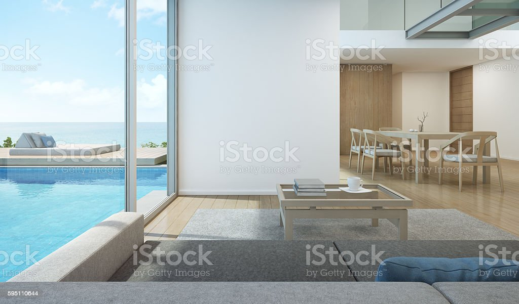 Sea view living room and dining room in pool house stock photo