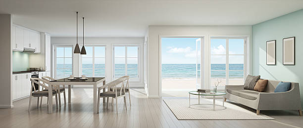 sea view living room, dining room and kitchen, beach house - modernes ferienhaus stock-fotos und bilder
