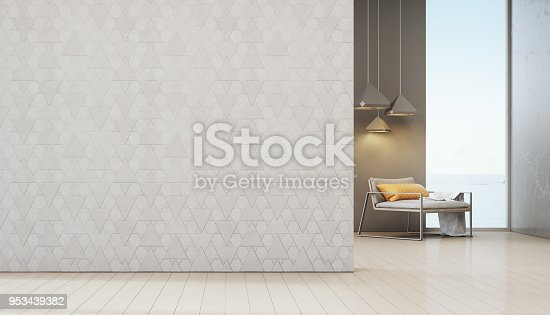 649067260istockphoto Sea view living room of luxury beach house with armchair near window on wooden floor. Empty white triangle pattern wall background in vacation home or holiday villa. 953439382