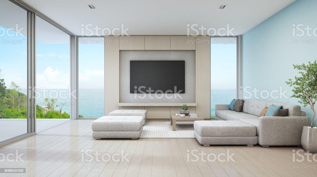 Meer Blick Wohnzimmer Luxus Strandhaus Mit Glastür Und Holzterrasse. Großen  Weißen Sofa Gegen Blaue Wand