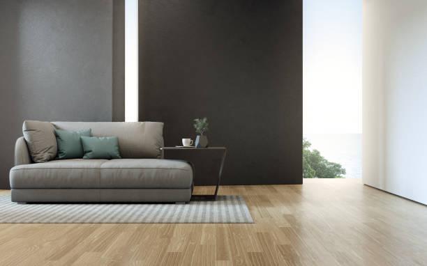 木製の床にソファが備わり、豪華なビーチハウスの海の景色を望むリビングルーム。 - ソファ 無人 ストックフォトと画像