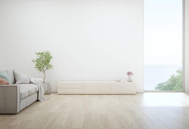 vardagsrum med havsutsikt på lyxiga sommaren beach house med tv-stativet och trä skåp. tom vit betongvägg bakgrund i semester hem eller semester villa. - looking inside inside cabinet bildbanksfoton och bilder