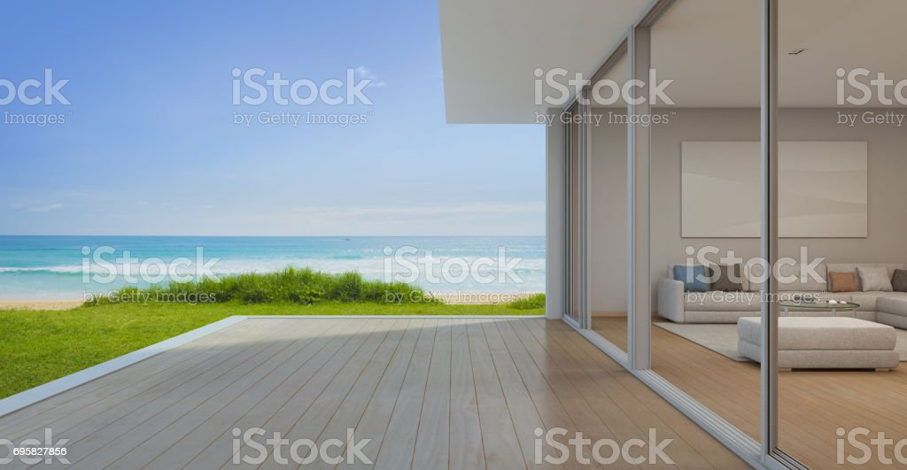 Sea view Living room with empty terrace in modern luxury beach house, Vacation home for big family stock photo