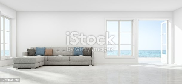 istock Sea view living room with empty wall in modern beach house, Luxury white interior of summer home 672865258
