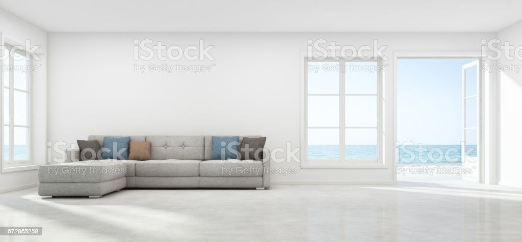Sea view living room with empty wall in modern beach house, Luxury white interior of summer home stock photo