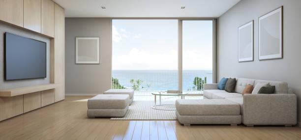 wohn-zimmer mit meerblick mit terrasse im modernen luxus-strandhaus, ferienhaus für große familie - ozean kunst stock-fotos und bilder