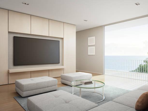 wohn-zimmer mit meerblick mit terrasse im modernen luxus-strandhaus, ferienhaus für große familie - große wohnzimmer stock-fotos und bilder