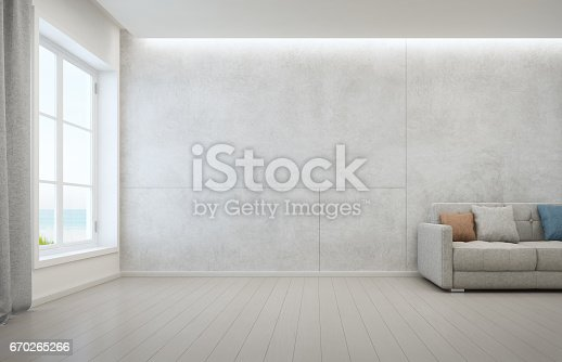 istock Sea view living room with wooden floor and concrete wall background in modern beach house, White interior of vacation home 670265266