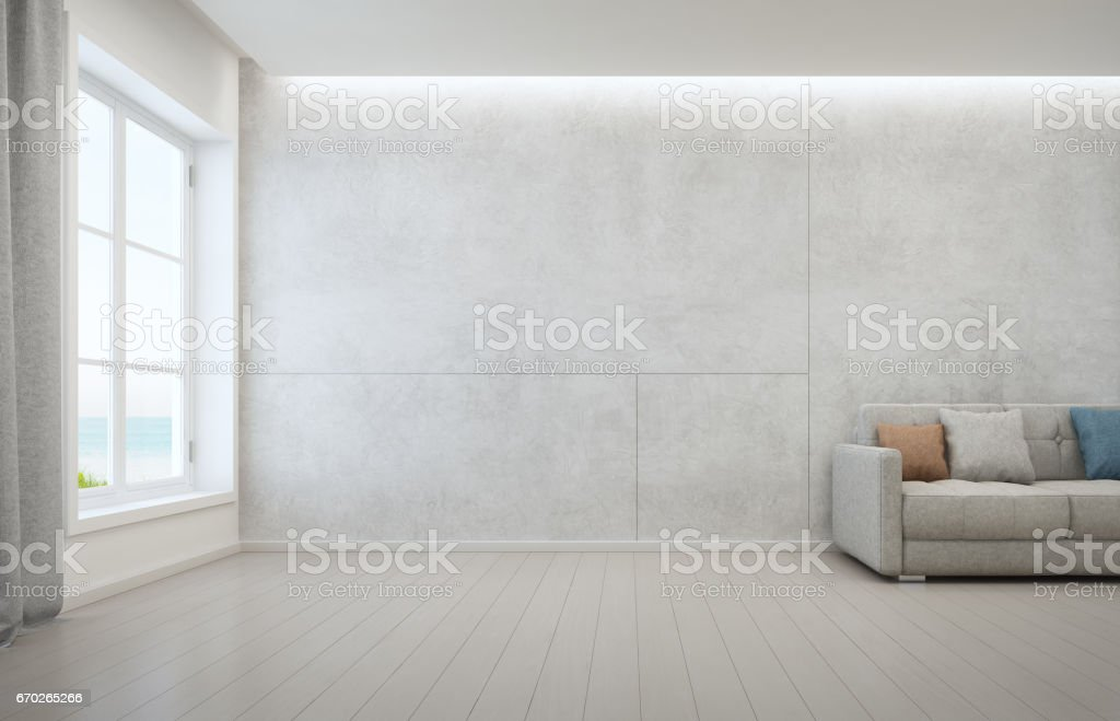 Sea view living room with wooden floor and concrete wall background in modern beach house, White interior of vacation home stock photo