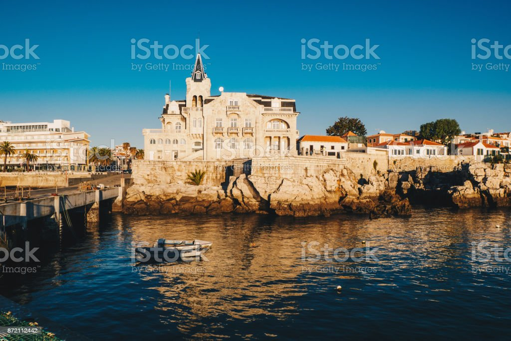 Sea view of Cascais city in Portugal at sunrise with fishing boats visible stock photo