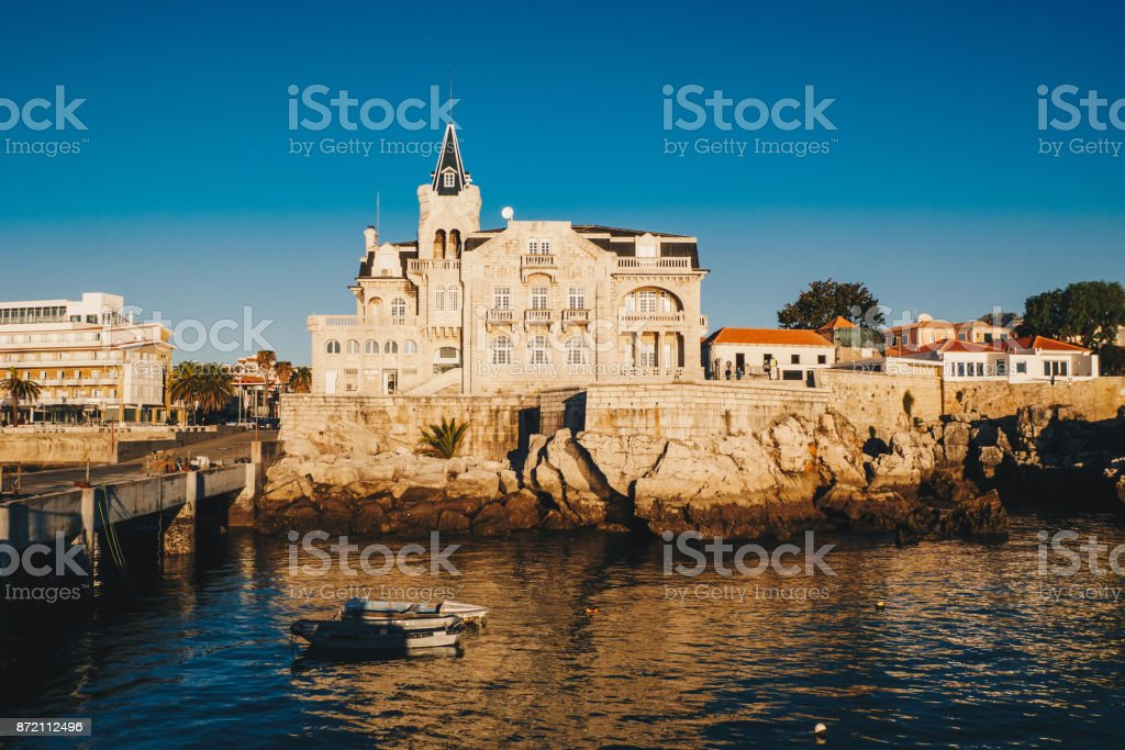 Sea view of Cascais city in Portugal at sunrise with fishing boats visible. Cascais, Lisbon District, Portugal stock photo