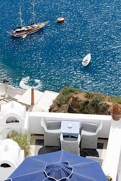 Sea view on yacht from restaurant's terrace Santorini island, Greece stock photo