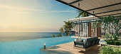 Sea View Andaman sea Beautiful Swimming pool with armchair and wooden floor  - 3d rendering