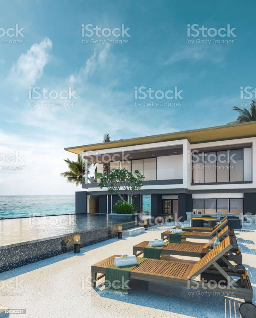 Sea view swimming pool in modern loft design,Luxury ocean Beach house stock photo