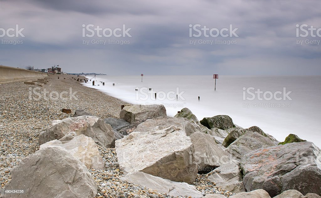 Sea wall, rocks and shingle, Aldeburgh, Suffolk, UK stock photo