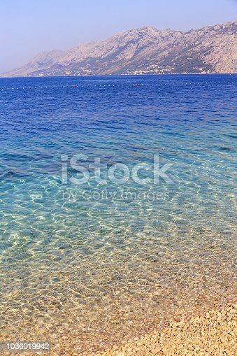 istock Sea water abstract background of Dalmatian coast in Croatia at day 1036019942